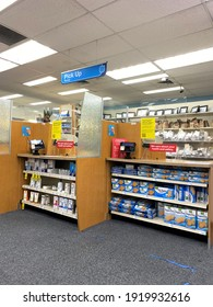 Miami, Fl, USA: Feb 18, 2021: CVS pharmacy counter, interior. No one is in line, empty. Covid-19 information near the counters regarding the vaccine and flu shot.