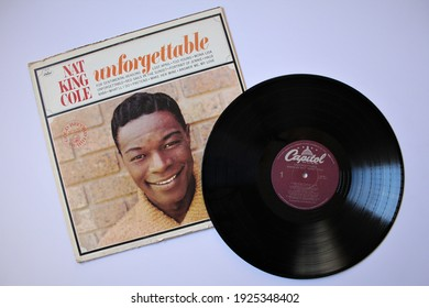Miami, Fl, USA: Feb 26, 2021: Jazz artist, Nat King Cole music album on vinyl record LP disc. Titled: Unforgettable album cover