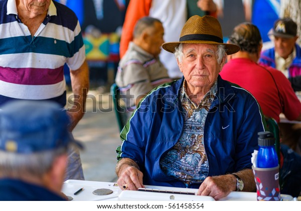 Miami, FL USA - January 11, 2017: Unidentified elderly man plays the domino game in the historic Domino Park in popular Little Havana.