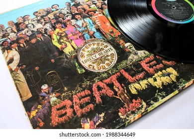 Miami, FL, USA: June 2021: Sgt. Peppers Lonely Hearts Club Band is a record by the English rock band The Beatles. Music album is on a vinyl record LP disc. Psychedelic pop
