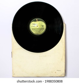 Miami, FL, USA: June 2021: The Beatles, also known as the White Album a record by the English rock band The Beatles. This music album is on a vinyl record LP disc. Psychedelic pop music. Album cover