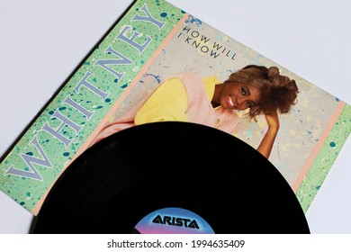 Miami, FL, USA: June 2021: Dance-rock, RnB and pop artist, Whitney Houston music album on vinyl record LP disc. Titled: Whitney single How Will I know album cover