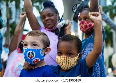 Miami, FL, USA - JUNE 7, 2020: White and black boys together. Friends. Anti racism demonstration. Children of different races together
