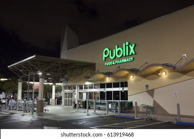 Miami, FL, USA - March 12, 2017: Publix food and pharmacy grocery store illuminated at night. Miami, Florida, United States