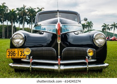 Miami, FL USA - March 12, 2017: Close up view of the front end of a beautifully restored vintage 1941 Studebaker Commander automobile at a public car show along Palmetto Bay in Miami.