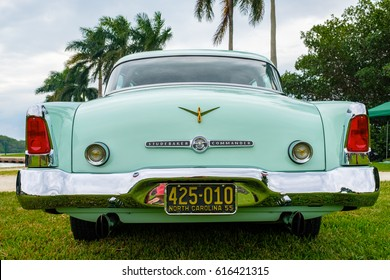 Miami, FL USA - March 12, 2017: Close up view of the rear end of a beautifully restored vintage 1955 Studebaker Commander automobile at a public car show along Palmetto Bay in Miami.