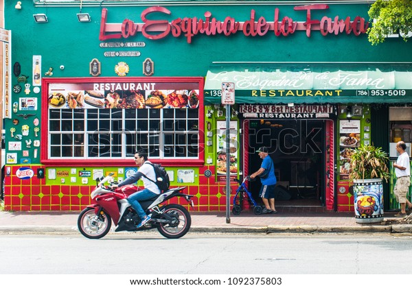 Miami, FL, USA - May 8, 2018: Scenes of daily life in Little Havana play out amidst a backdrop of pulsating traditional Cuban and Afro-Cuban music, storefronts, art galleries and quaint restaurants.