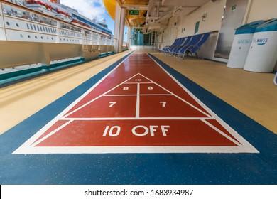 MIAMI, FL, USA - OCTOBER 12, 2019: A shuffleboard court on the deck of a Royal Caribbean cruise ship.