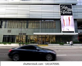 Miami, Fla./USA-Feb. 5, 2018: A car passes the Saks Fifth Avenue in Brickell City Centre, a new retail complex in downtown Miami.
