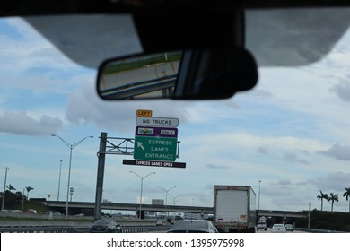 MIAMI, FLORIDA - 10 MAY 2019 - View of a tollbooth on the road at the entrance. Sunpass holders go through an express lane