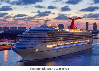 Miami, Florida - April 04 2014: Carnival Victory Cruise Ship sailing at sunrise in the Port of Miami.
