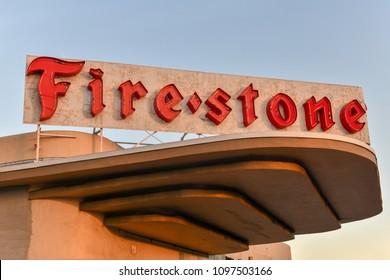 Miami, Florida - April 28, 2018: Vintage Firestone Tire Company Sign in Miami, Florida