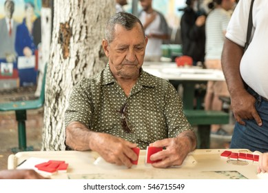 MIAMI, FLORIDA - APRIL 29, 2015: Little Havana district in Miami and People playing Domino in Maximo Gomez Park Domino Park