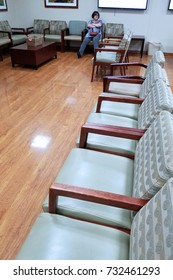 Miami, FLORIDA – August 13, 2016:  A lonely and desperate woman is waiting in an hospital waiting room for her husband to come out of emergency surgery in the middle of the night.