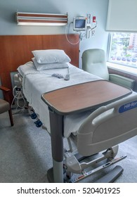 Miami, FLORIDA August 16, 2016: A modern hospital bed waiting to be occupied by a patient. Modern hospital beds are equipped with features from emergencies utilities to entertainment