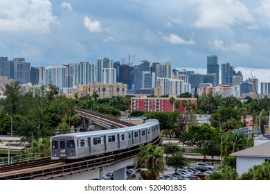 Miami, FLORIDA . August 30, 2016: The Miami Metrorail heading towards downtown. Public transportation is becoming more important in urban life.