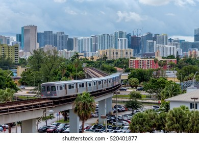 Miami, FLORIDA  August 30, 2016: The Miami Metrorail heading towards downtown. Public transportation is becoming more important in urban life.