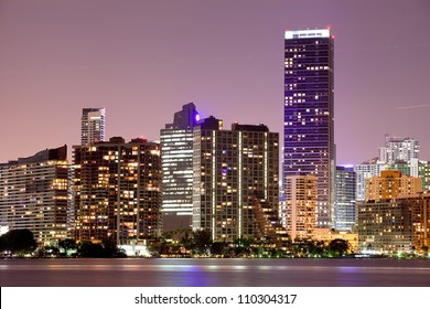 Miami Florida  buildings cityscape at night.  Illuminated business and luxury residential buildings and hotels. Long exposure panorama of World famous travel location.