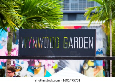 Miami, Florida - December 29, 2019: Closeup of Wynwood Garden metal sign at colorful contemporary Wynwood Walls outdoor art district graffiti mural painting museum