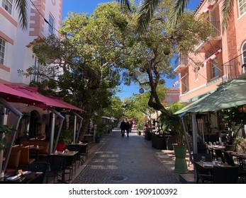 Miami, Florida - February 03, 2021: Unidentified couple walking a restaurant area in Miami beach in Miami, Florida