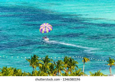 Miami, Florida - February 28, 2018:  An unidentified man prepares to get harnessed for a parasailing adventure in Miami, Florida.