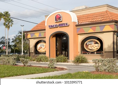 Miami, Florida January 19, 2018: Exterior of Taco Bell fast-food restaurant with sign and logo.