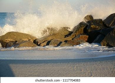 Miami, Florida - January, 4, 2018: Ocean crashing the rock at Haulover Beach Park in Florida