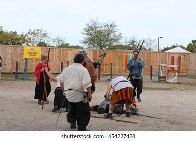 MIAMI, FLORIDA - MARCH 12, 2016: Knights battle at Renaissance Fair in authentic costumes, Renfair