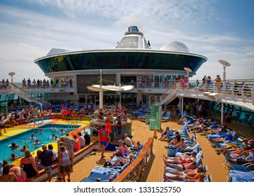 MIAMI, FLORIDA - March 2, 2016: In spite of the new and innovative things to do on modern cruise ships, pool activities remain at the top of the most popular list.