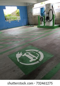 Miami, FLORIDA – October 02, 2017:  An electric car charging station in the parking garage of a local mall waiting for a car to arrive in need of a charge