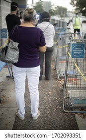 """Miami, Florida / United States - April 12th 2020: Miami residents shopping food and essentials during """"stay at home"""" order."""