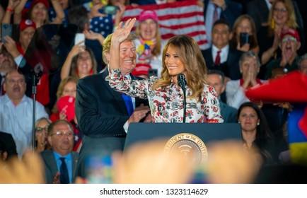 MIAMI, FLORIDA / UNITED STATES - FEBRUARY 25, 2019: President Donald Trump  and First Lady Melania Trump speak at Florida International University regarding the ongoing crisis in Venezuela.