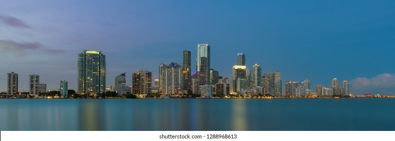 MIAMI, FLORIDA, USA - DECEMBER 14, 2018: Panoramic of the Miami skyline at night from the William M. Powell Bridge