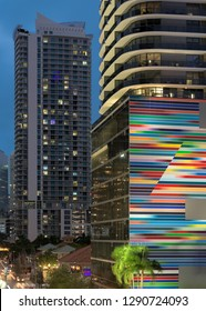 MIAMI, FLORIDA, USA - DECEMBER 15, 2018: Colorful SLS LUX Brickell Condos at night in downtown Miami