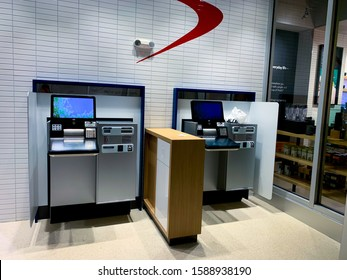 MIAMI, FLORIDA / USA - February 28, 2019: The logo and ATM of Capital One Bank in office, cafe building. A bank holding company specializing in credit cards, auto loans, banking, and savings accounts.