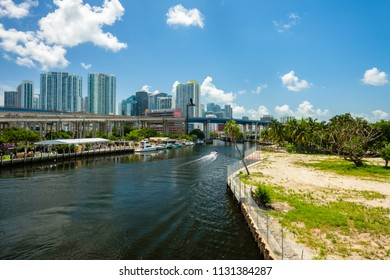 Miami, Florida USA - July 9, 2018: Scenic Miami River cityscape with docks and boats and the downtown skyline.