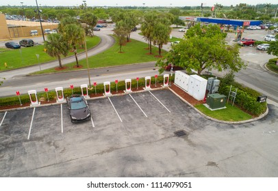 MIAMI, FLORIDA, USA - JUNE 9, 2018: Aerial image of a Tesla Model s charging at a supercharger