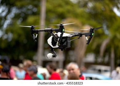 Miami, Florida, USA - March 13, 2016: Quadrocopter drone (four rotor remotely controlled helicopter) flying in the sky in a park in Miami. Florida, USA on March 13, 2016