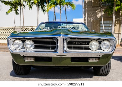 Miami, Florida USA - March 5, 2017: Close up view of the front end of a beautifully restored 1967 Pontiac Firebird convertible at a public car show.