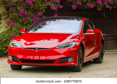 MIAMI, FLORIDA, USA - MAY 12, 2018: Image of a new Tesla model s charging at home