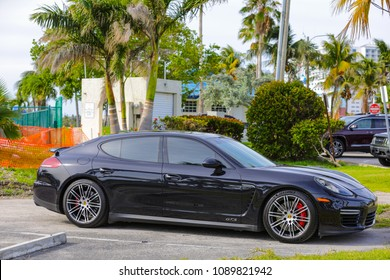 MIAMI, FLORIDA, USA - MAY 12, 2018: Image of a 2016 Porsche Panamera GTS in black with tinted windows in a parking lot