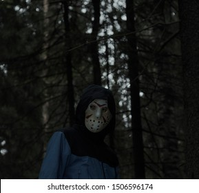 Miami, Florida USA - May 3, 2019. Friday 13th hockey mask of Jason Voorhees. Halloween concept. day of death. man in a jason mask on a black background.