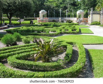 Miami, Florida USA - October 6, 2010: Wide view of a portion of the ornamental parterre garden, topiary hedges and gazebo of Villa Vizcaya, now the Vizcaya Museum and Gardens near Biscayne Bay.