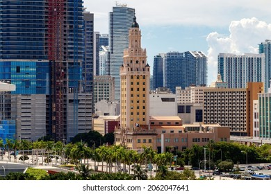 Miami, Florida, USA - September 25th, 2021 - Downtown city skyscraper buildings with focus on Freedom Tower Miami-Dade College Art Museum. Originally Spanish Mediterranean Revival newspaper printing