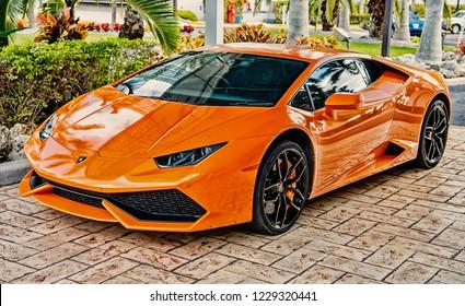 Miami, Florida, USA-February 19, 2016: Supercar Lamborghini Aventador orange color parked next to Ocean drive at South bech at Miami, Florida. Lamborghini car is famous expensive automobile brand car