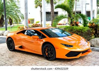 Miami, Florida, USA-February 19, 2016: Supercar Lamborghini Aventador orange color parked next to Ocean drive at South bech at Miami, Florida. Lamborghini is famous expensive automobile brand car