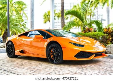Miami, Florida, USA-February 19, 2016: Supercar Lamborghini Aventador orange color parked next to Ocean drive at South bech at Miami, Florida. Lamborghini is famous expensive automobile brand car