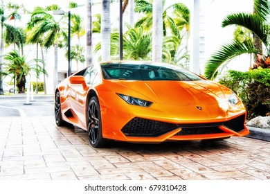 Miami, Florida, USA-February 19, 2016: Supercar Lamborghini Aventador orange color parked next to Ocean drive at South bech at Miami, Florida. Lamborghini car is famous expensive automobile brand car