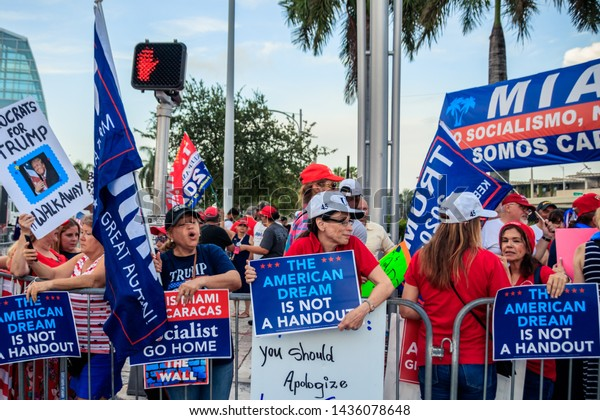 Miami, Florida/USA - June 27, 2019: Republicans and Trump supporters standing outside with signs and posters. First Democratic Debates 2019 Second Round. Against Joe Biden and Bernie Sanders.