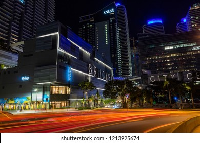 Miami, Florida/USA-10/01/2018: Night time photo of Brickell City Center in the Business District of Miami with passing traffic light trails in the foreground and East Hotel in the background.